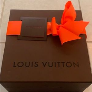 Louis Vuitton box with bow and unused tag.